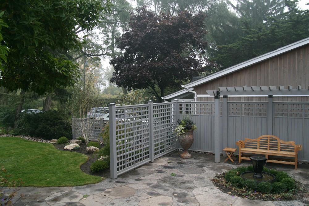 side courtyard garden, privacy screen, arbor, natural flagstone, urn, teak bench,fence