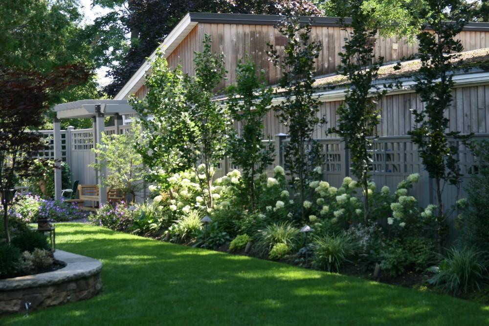 fence, arbor, columnar beeches, teak bench, fountain