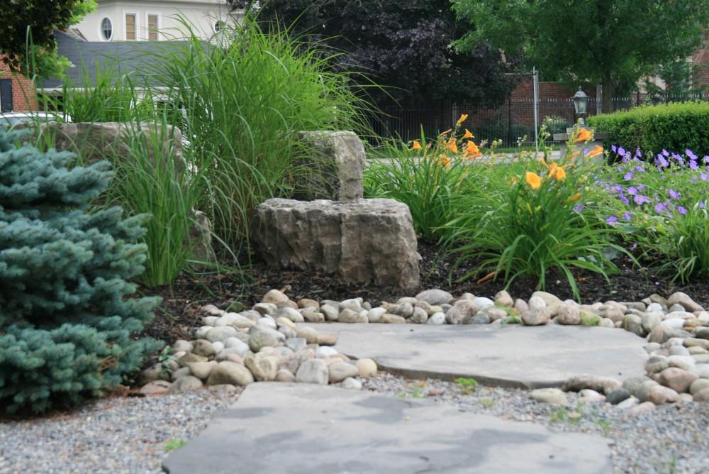 circular driveway, rockery, armor stone, grasses, natural stone slab